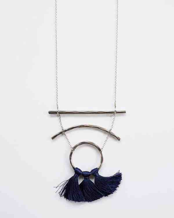 Sterling silver chain with navy tassels on it