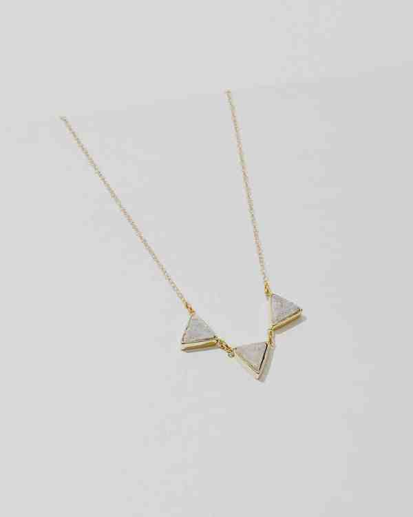 brass necklace with white triangle stones hanging