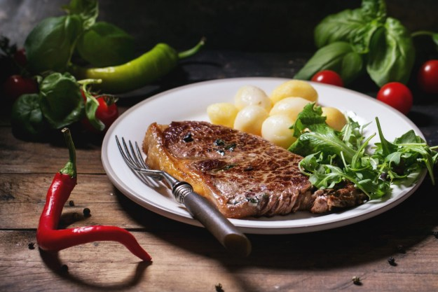 Grilled steak with green salad
