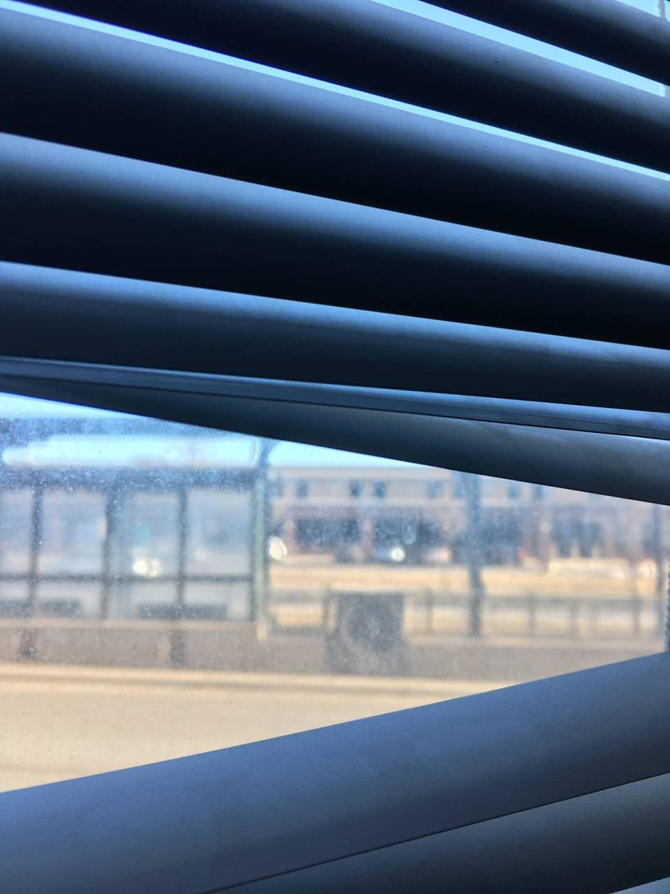 Peeking through the blinds reveals the Westgate Light Rail Station's Eastbound platform just steps across the street from our new HQ. Transit access for the win!
