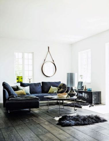 white living room with navy blue sofa