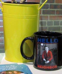 Mr Rogers coffee mug on a counter top
