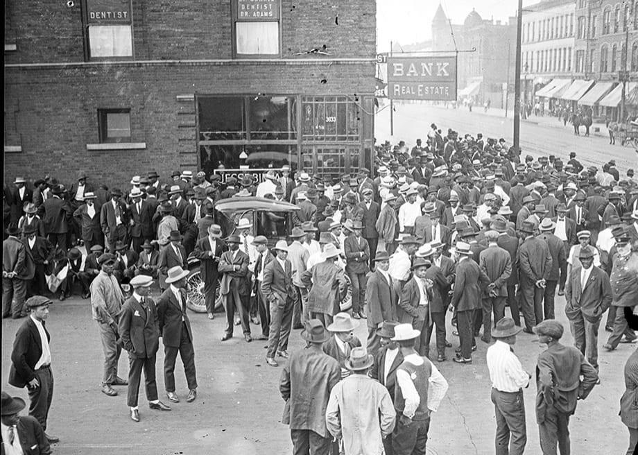 Black men in Chicago in 1919, stood in resistance against white mobs.