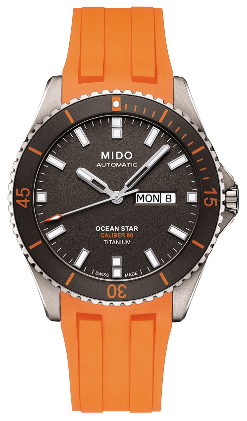 Mido Ocean Star Calibre 80 Titanium. Mouvement automatique Mido Calibre 80 (base ETA C07.621). Boîte en titane satiné et poli de 42,5 mm de diamètre, lunette tournante unidirectionnelle avec bague en aluminium sablée anthracite. Bracelet caoutchouc orange, boucle déployante en titane avec extension plongeur.