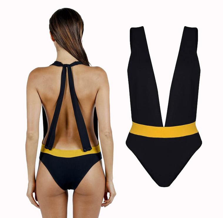 LUZ COLLECTION. César, un maillot de bain une pièce noir et jaune, décolleté plongeant devant et derrière. Système d'attache à nouer ou boutonner avec dos découvert. Destiné au corps de sirène.  130 €