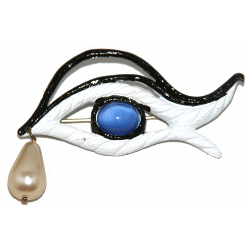 Schiaparelli réinterprète l'œil de Cocteau. Broche des années 1950.