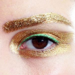 Gold Brows and Shadow with Green Liner Highlights Brown Eyes