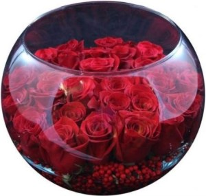 A Beautiful Glass Rose Bowl Filled With Red Roses and Berries. Photo AristonFlowers.com.