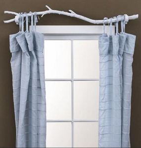 Save on window hardware with natural elements; you can also use this idea as a closet hanging tier. CasaSugar.Com
