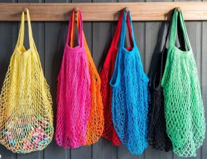 French net shopping bags are THE classic tote. They are stashable, expandable, adaptable, environmentally responsible, washable, last forever, and they look slick. You can pick these up pretty much everywhere. A great option for a kid.