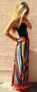 Another FashionGum.com example of how to pull off a colorful BoHo skirt. Note the importance of the cuff bracelet to making this look work.
