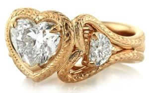 Side view showing the incredible detailing of the heart ring available at MarkBroumand.com.