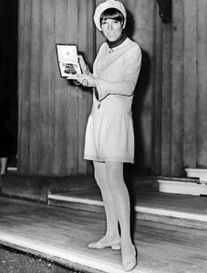 Mary Quant receiving the Order of the British Empire Medal for designing the mini skirt. Well, for her 'contribution to British Fashion' (being, most notably, the mini skirt).... Notice she is also rocking a beret. Photo via nydailynews.com.