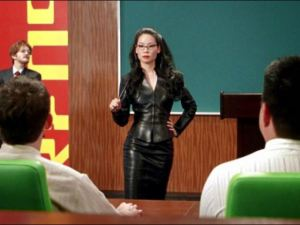 "Scene from Lucy Liu's hilarious performance as a motivational instructor in the iconic film ""Charlie's Angels"". Drew Barrymore, in drag, lurks in the background, on the left."