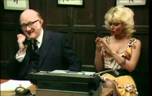 """""""I can't use Technology...I might break a nail."""" Candy Davis as Miss Belfridge, shown here with Nicholas Smith, from the hilarious vintage television series """"Are You Being Served?"""""""