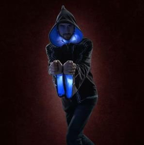 """This jacket has a learning curve that seems to approximate mastering Tai Chi. That won't likely be an issue for gamer girls and guys. Built-in (but removable for washing) sensors and light strips all hook together and respond to specific body movements to generate an astonishing variety of """"spells"""" with corresponding sound and light effects. Plan your environment to enhance the effect, but be sure to have lots of Mana on hand for refreshment. Technomancer 2.0 Digital Wizard Master Jacket. thinkgeek.com."""