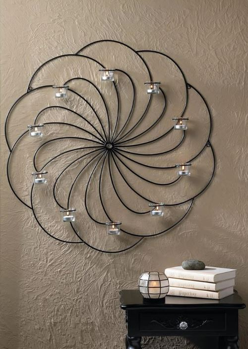 A dramatic 30-inch candle display for your wall. Clancy Circular Wall Decor Candle Holder. overstock.com
