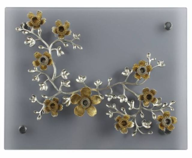 Handcrafted Wildflower Metal Menorah with Smoked Glass Base. https://www.traditionsjewishgifts.com/handcrafted-wild-flower-hanukkah-menorah-QUMEN59A.html
