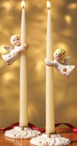 """This cute set features four pieces: Two bases to hold tapers (not included), and two angel """"huggers"""" that fit over the candles. The angels seem to hover in mid-air. With a retro look and soft, glimmering metallic accents, these delightful little Christmas friends will be welcome sights every year in your holiday decor. 4 Piece Set Flying Angel Candle Huggers And Bases. Vermontcountrystore.com"""