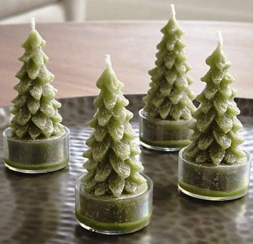 Tea lights don't have to be boring. These shoot upward to create a precious tiny pine forest. Green Tree Candles Set of Four. Crateandbarrel.com
