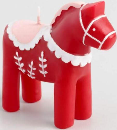 There aren't just Christmas Deer--There are also Christmas Horses. Traditional Scandi Dala Horse Candle. Worldmarket.com