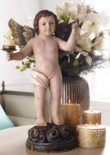 Just one of several styles of lovely Old-World style figurines, this cherub holds a candle aloft with one hand, and gives the Royal Wave with the other. Standing Cherub Candle Holder. Wisteria.com