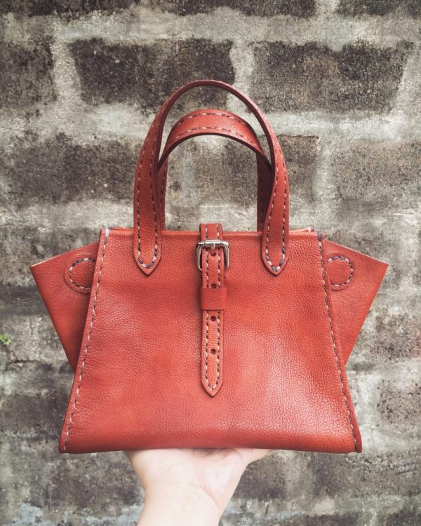 buckled leather tote