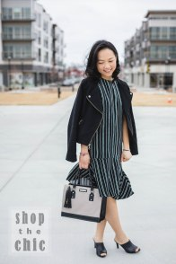 Stunning! Model-outfit-purse. I love the grey and black color of the purse. The color gives it some neutrality and, yet, at the same time gives it contrast from an all-black or all-grey purse look. The tassel also gives it some character which I love.