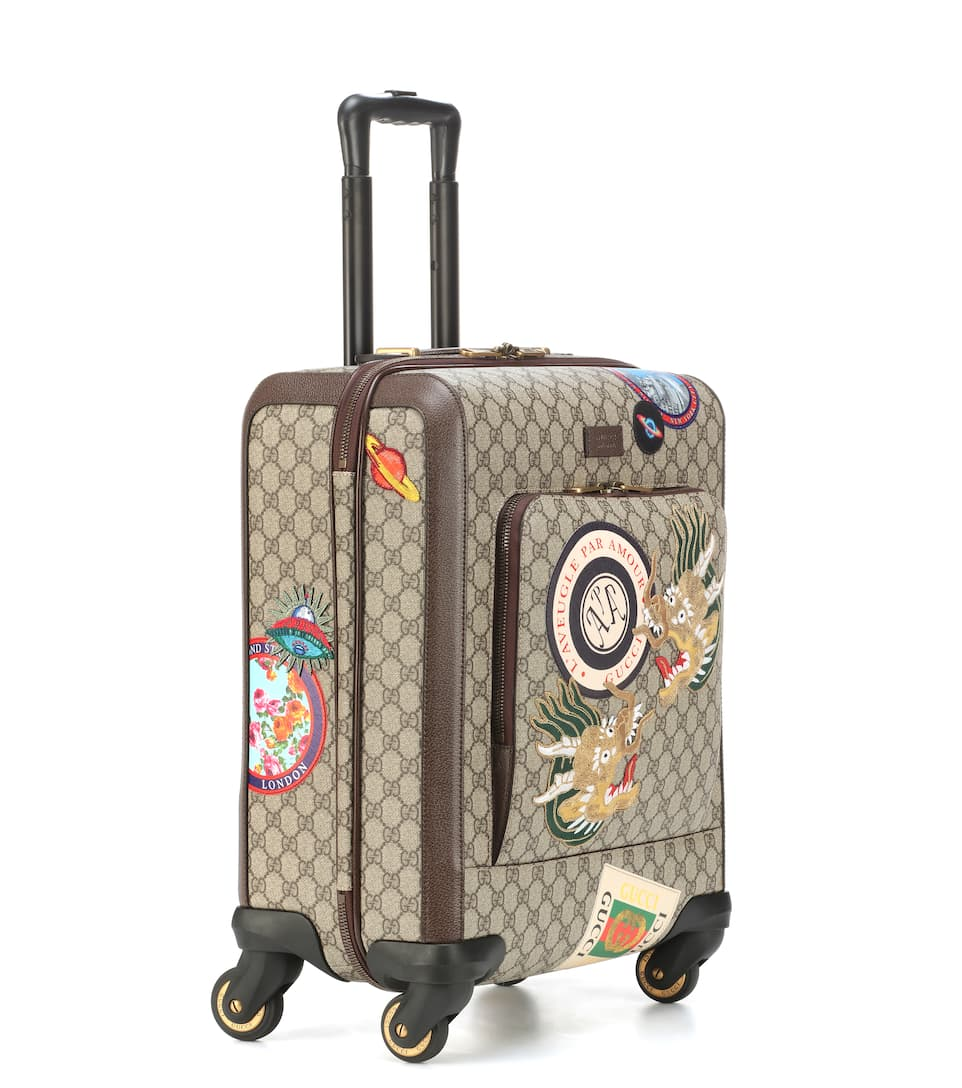 gucci alessandro michele trolley patchwork ufo draghi loghi tessuto