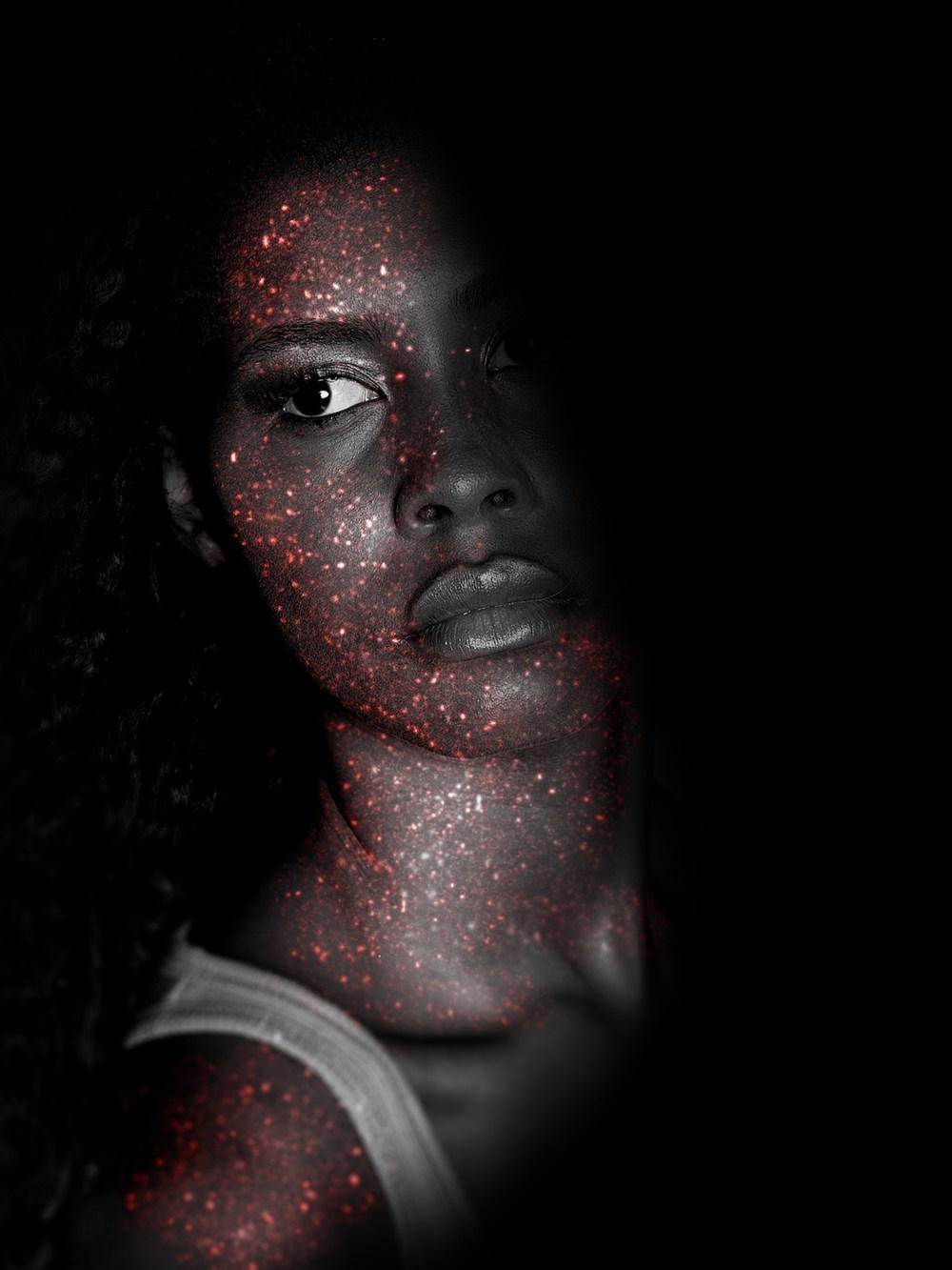 A woman wearing face glitter