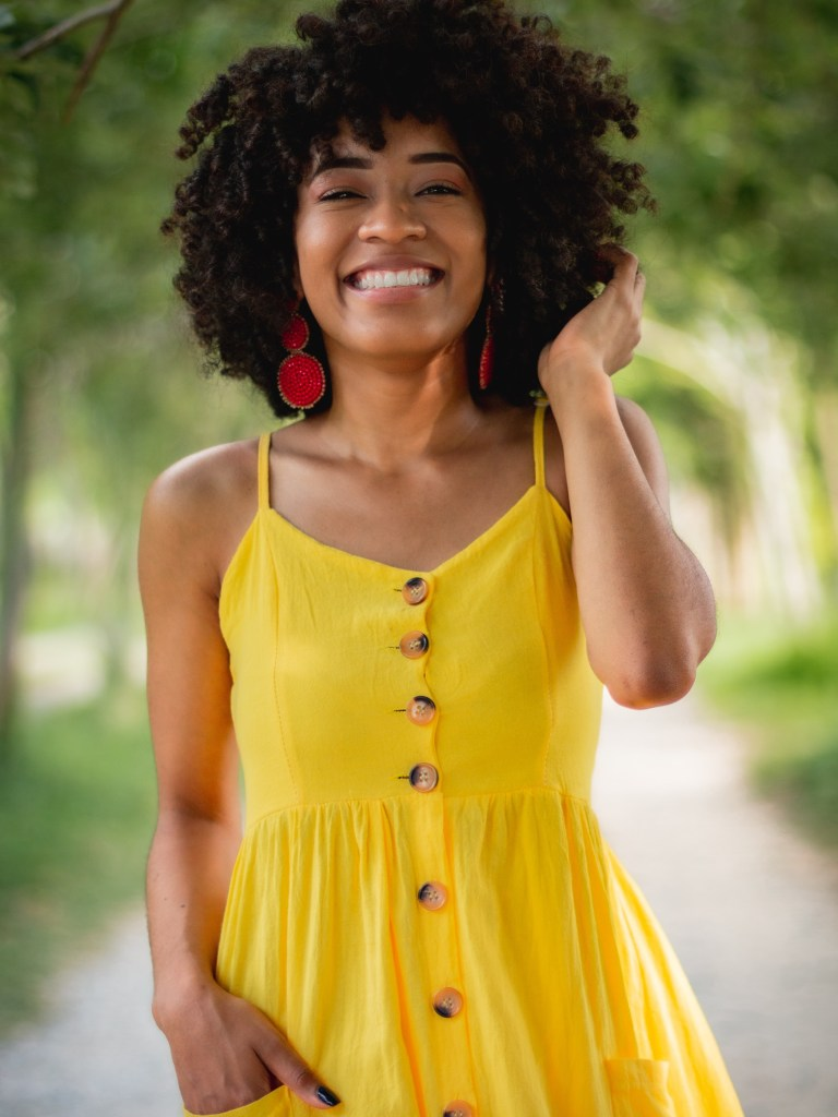 A woman in a yellow dress to represent black girl magic