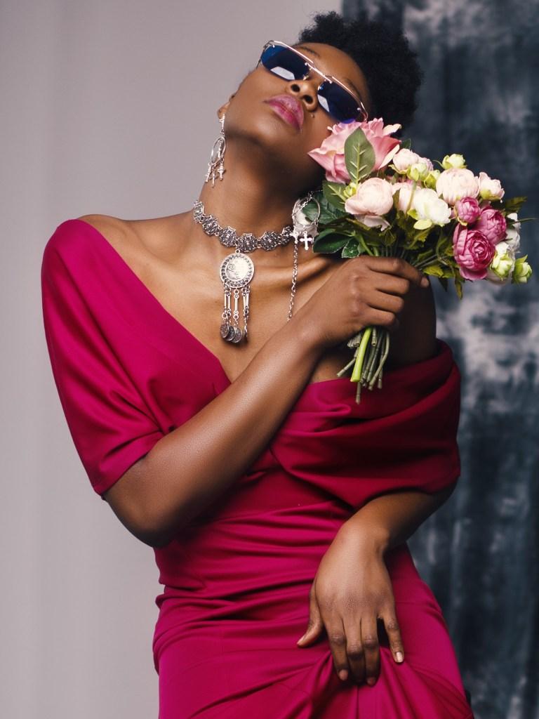 Lady in a magenta dress wearing a silver statement choker