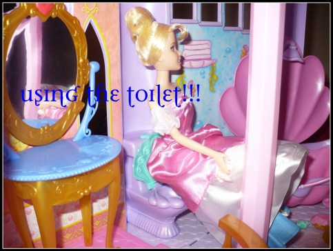 Disney Princess Ultimate Dream Castle Barbie using the toilet