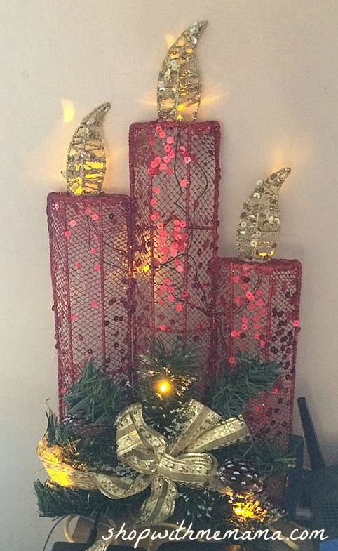 light up Christmas candles with pine tree decor