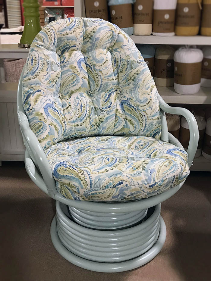 paisley blue and green rattan swivel chair