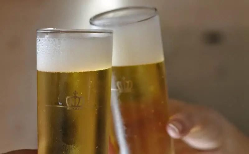 Two beers cheersing