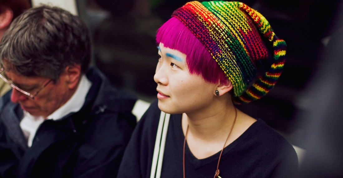 asian girl with bright pink hair on the tube