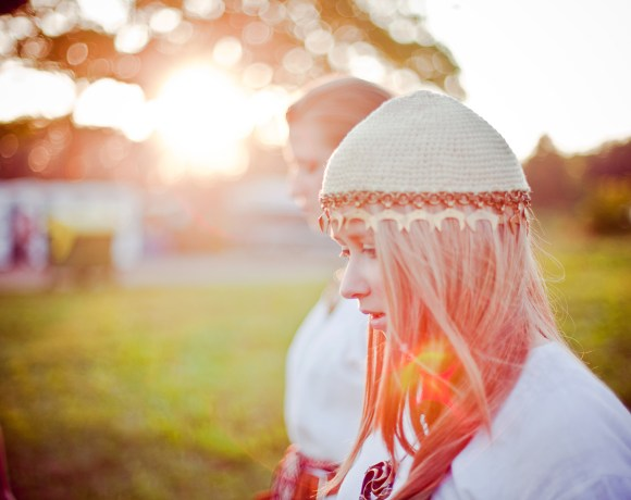 girl in traditional lithuanian attire at sunset
