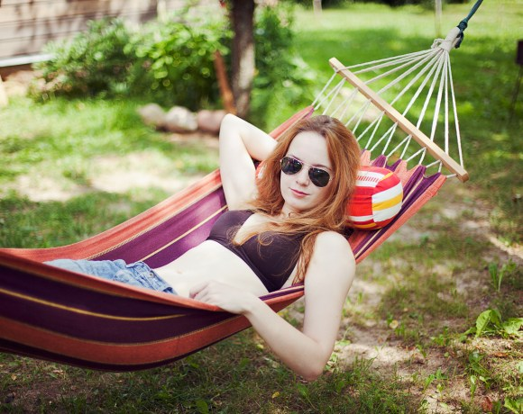 girl in a hammock with sunglasses on
