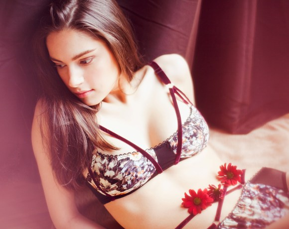 model with dark hair in dreamy lingerie with red flowers