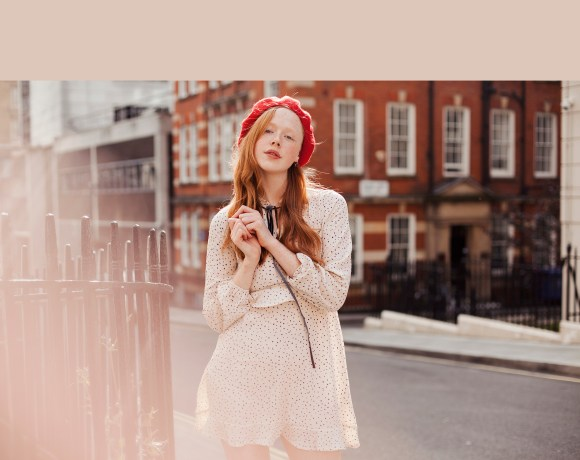 Redhead fashion blogger Holly Rebecca White in a red beret and white dress by Ailera Stone