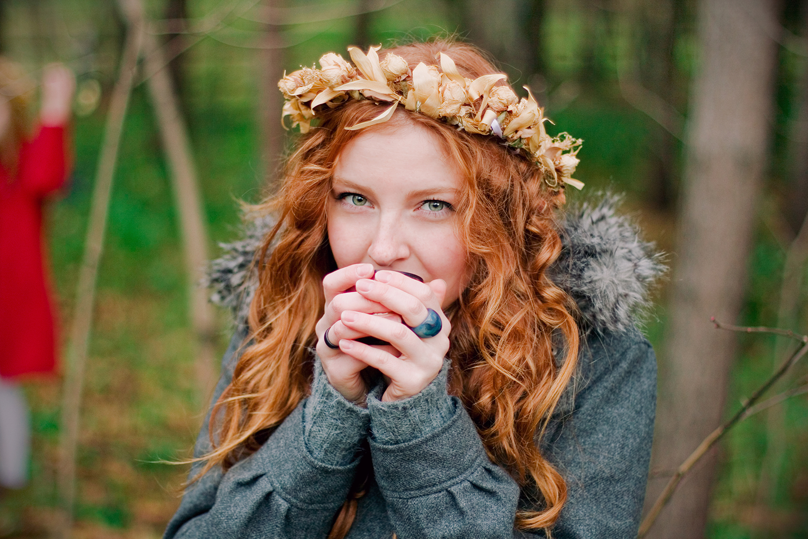 redhead with a flower crown drinking tea by Ailera Stone