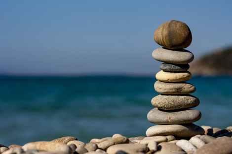 balanced decision making :balance macro ocean pebbles