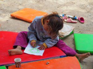 little refugee kid drawing