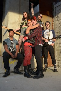 (left to right) Steven Perkins, Becca Brown, Malic White, Luke Linsteadt, David Daniel Smith and Jay Cullen in a publicity image for The Hypocrites' Chicago premiere of AMERICAN IDIOT with book by Billie Joe Armstrong and Michael Mayer, music by Green Day, lyrics by Billie Joe Armstrong, direction by Steven Wilson and musical direction by Andra Velis Simon. Photo by John Taflan.
