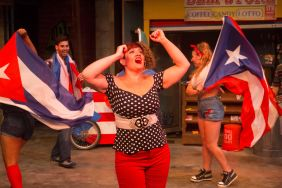 """Missy Aguilar as """"Daniela"""" and the cast of In The Heights perform """"Carnaval Del Barrio"""""""