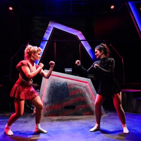 left to right) Amanda Horvath and Courtney Mack in Underscore Theatre Company's Chicago premiere of TONYA AND NANCY: THE ROCK OPERA. Photo by Evan Hanover.