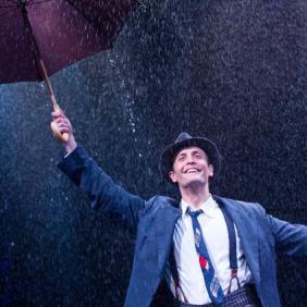 "Danny Gardner as Don Lockwood in ""Singin' in the Rain"" at The Marriott Theatre."
