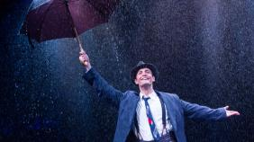 "Danny Gardner as Don Lockwood in ""Singin' in the Rain"" at The Marriott Theatre."