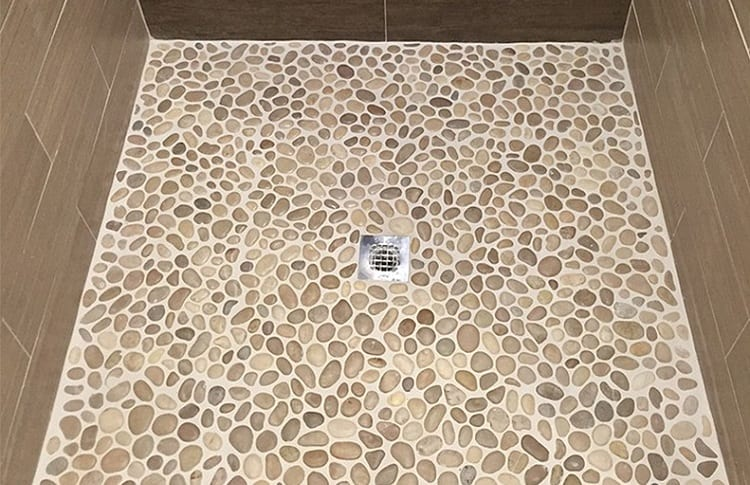 pebble shower floor pros and cons